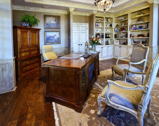 """Marcia's office at Cedar Hill is her command post as """"farm manager"""" and is decorated with, among other things, her clock collection on the bookshelves."""