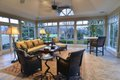 The large first-floor garden room brings the outside in and features comfortable seating by Century Furniture.