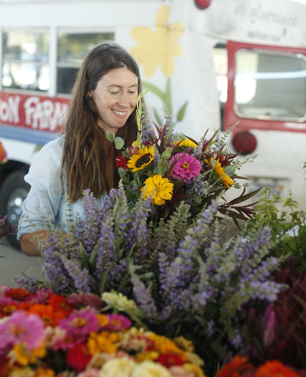 Jill arranging her flowers into bouquets for her Farmers Market CSA subscribers.