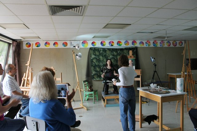 Portrait artist Mary Minifie demonstrates her technique during a workshop
