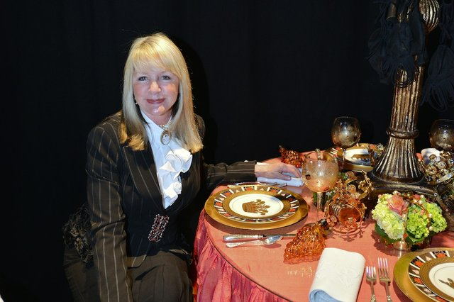 Lucy Woodson at a table designed with Shirley Turner
