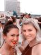 """Me & hair goddess Lucy Hadskey at the """"Flyer"""" Open Model Call at The Peabody Rooftop Party. My """"before hair"""" — dark locks are pulled up in a bun and you can actually see some pesky greys peeking thru. Lucy looks hot, of course."""
