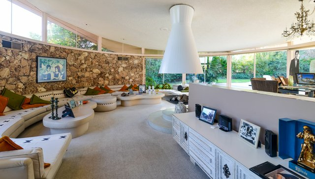 The famous circular living room with its built-in 64-foot curved sofa has surely been the scene of many parties over the past 54 years.