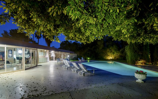 A view of the back pool area at dusk.