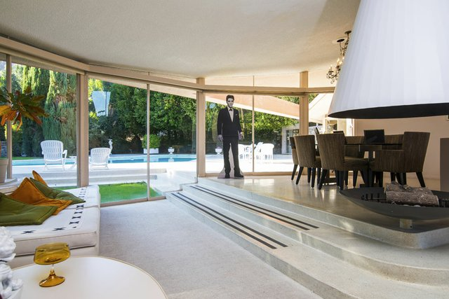 An Elvis cutout holds sway in the Ladera Circle home's large living room which represents indoor/outdoor living at its mid-century-modern best.