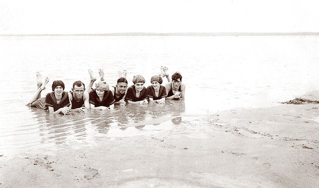 In the early 1900s, nobody went bathing unless they were almost fully clothed. These unidentified men and women, splashing along the banks of the Mississippi River, wore the latest fashions, including swimming caps for the ladies.