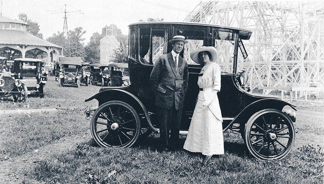 """A scribbled caption ID's this couple as """"Mr. and Mrs. Howard Chapman Boaz."""" The photo was taken at East End Park in 1912 with the original Zippin Pippin in the background. When East End closed the roller coaster was moved to the Mid-South Fairgrounds."""