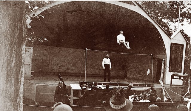 The Frill Act, 1910, featured high-wire performers, such as this gentleman seated in a chair while balancing on a tightrope.