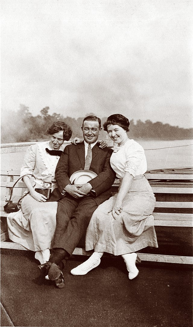 "The caption says it all: ""Contented: Lena, Joe, Agnes."" That's Joe Bennett in the center, in this tranquil boating scene."