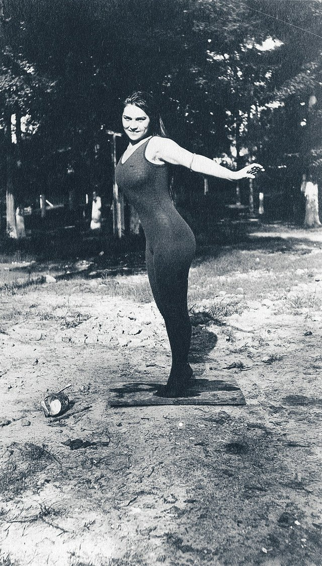"""This woman in black tights is probably a circus performer. Just imagine how """"scandalous"""" such a costume would have been in 1912."""
