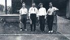 Then as now, a tennis match was a good way to spend a summer afternoon. Joe Bennett stands second from the left; the other players are unknown.