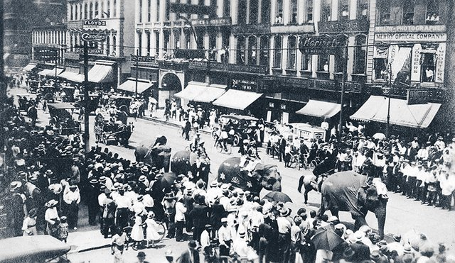 How many times have elephants lumbered down Main Street? This view, looking south on Main towards Union, shows a circus parade.