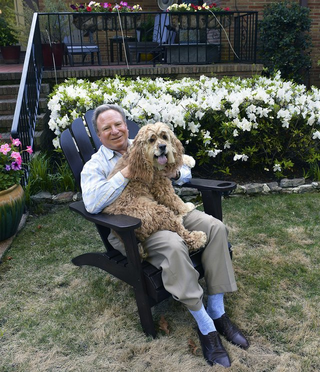 Nathanson kicks back with his faithful canine companion, Asa.