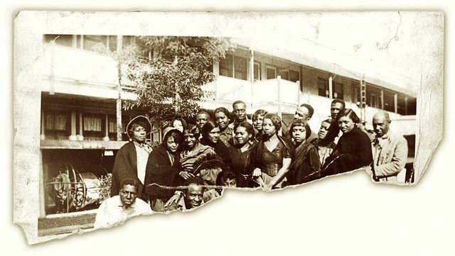 """Only the top half remains of this tattered photograph showing some of the cast of """"Hallelujah."""" Many of the performers here, along with the location, have never been identified."""