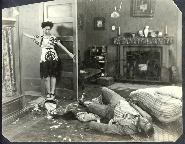 "The dramatic scene when Nina Mae McKinney as ""Chick"" finds the body of ""Hot Shot."""