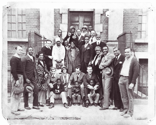 The Dixie Jubilee Singers at an unknown Memphis location with the rest of the movie cast and production crew. Director King Vidor is seated front and center. Georgia Rodgers Woodruff, the film's lead female singer, stands at left, wearing a white hat.