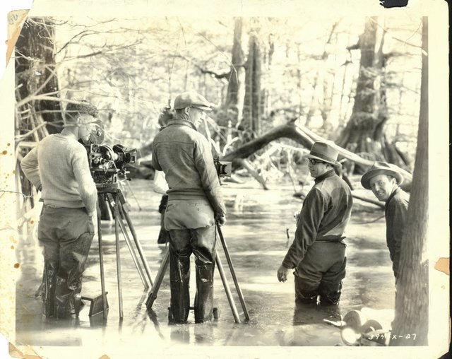Filming some scenes, such as this one in an Arkansas swamp, could be challenging. King Vidor is second from the right.