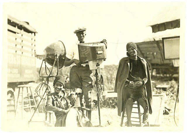 On location at Wilson Plantation in Arkansas, two unidentified performers relax with a member of the production crew. Historians are still trying to identify many of the men and women featured in the film.