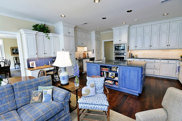 The open-plan kitchen and morning room show off Cannon's passion for the classic decorative combination of blue and white — in cabinetry, fabrics, and porcelain.