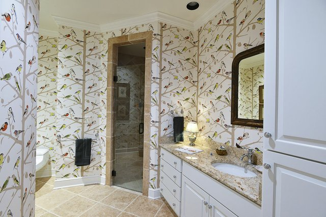A brightly colored and all-over patterned bath resembles nothing so much as a lovely aviary (that's birds!) — one of Cannon's favorite motifs for their home.