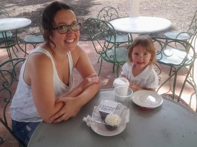 Nearby Midtown residents Diana Barzizza and her 3-year-old daughter, Eva, take a cupcake break on the patio at Muddy's Grind House on South Cooper Street.