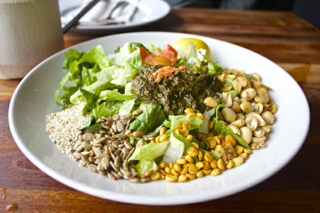 Tea Leaf Salad at Burma Superstar located in the Inner Richmond neighborhood of San Francisco is a show-stopping combination of peanuts, lentils, romaine, fried garlic, and fermented tea leaves.