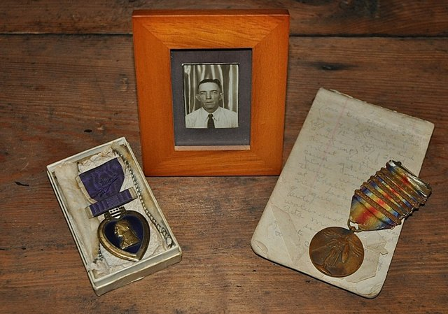 Cullen Finger, along with his tattered diary and two of the medals he earned as an Army sergeant during World War I
