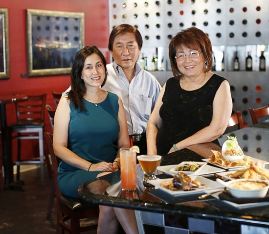 Lisa Ansley, David Wang, and Shelly Ansley are the powerhouse trio behind Wang's and East Tapas, their adjoining restaurant next door.
