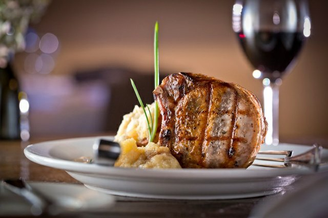Robust and satisfying, Napa's dry-aged porterhouse chop is served with roasted Granny Smith apple sauce, apple ginger demi-glace, and smoked bacon and blue cheese mashed potatoes. Owner Glenda Hastings, managing partner Rusty Prudhon, and Chef Ken Lu...