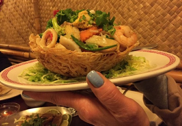 The Seafood Potato Nest pairs a charming presentation with vegetable and seafood stir-fry. Siblings Kimberly Lam and Victor Bach, pictured below, along with brother Bernard Bach, helped out Saturday night at Lotus, their parents' restaurant on Summer...