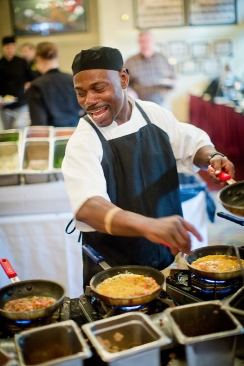 Chef and showman Shorty Fisher finesses the omelettes, a popular dish at Owen Brennan's renowned Sunday brunch.