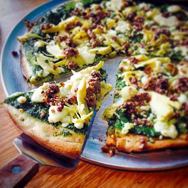 Signature pizzas highlight the menu at Maui Brick Oven, including the Paradise Pesto made with artichoke hearts, roasted garlic, and chopped green olives.