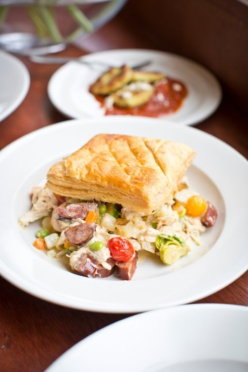 Classic chicken pot pie at the new Rizzo's Diner gets turned upside down with vegetables on the bottom and puff pastry on the top. The restaurant's chef, Michael Patrick, is pictured below.