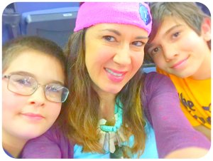 Me and my boys at a game earlier this season. Here, I'm wearing retro Grizz colors modified to make my coveted pink headband pop with the turquoise necklace by Brave Design. My sons are wearing a Tony Allen t-shirts by Eric Evans at Sache and a custo...