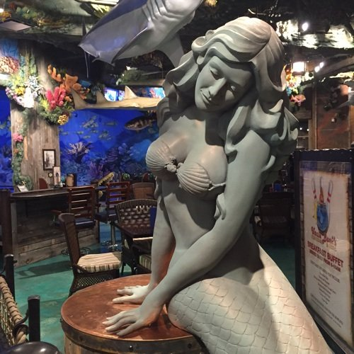 An aquatic theme, including the shapely mermaid above, informs the menu and decor at Uncle Buck's Fishbowl & Grill.