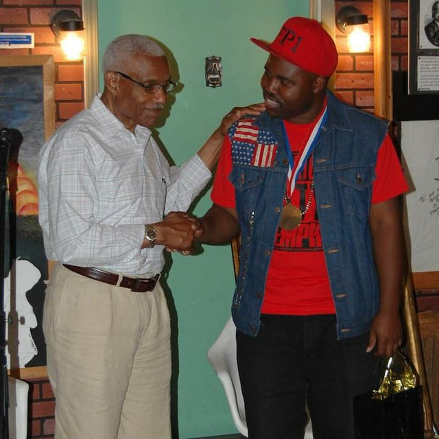 Terrence Boyce received his Lifetime Achievement Award from Mayor A C Wharton last Saturday at House of Mtenzi