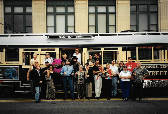 """Among those pictured celebrating the first Trolley Night on Sept. 29th, 2000, are Joey Williams (Bennett Stained Glass), Patsy Whitehead (The Charcoal Store), Brenda Durden (Durden Gallery), Martin Wilford (Red Deluxe), Jodie Vance (""""Downtowner"""" maga..."""