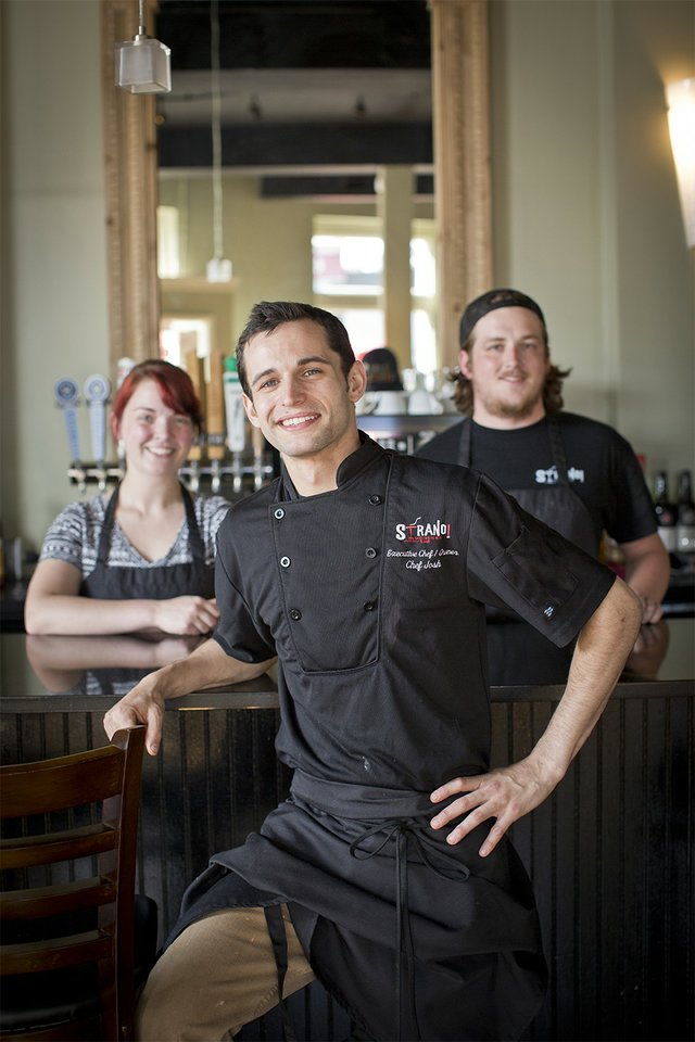 Chef/owner Josh Steiner, baker Emily Methvin, and sous chef Cole Owen are the kitchen team at Strano Sicilian Kitchen, serving family recipes along with updated pastas, pizzas, and seafood.